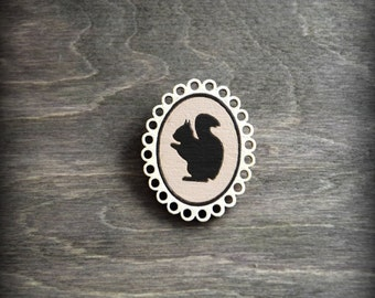 Wooden painted brooch cute and lovely squirrel. Brown and smooth white. Plywood and metall.
