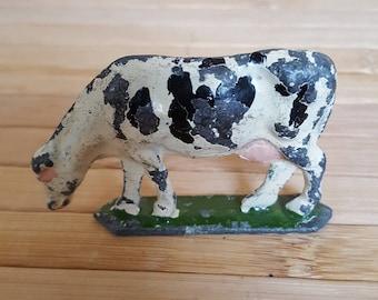 Lead cow, miniature cow, lead farm animal, vintage toy, antique cow.
