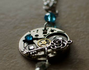 Pendant with watch mechanism made entirely by hand