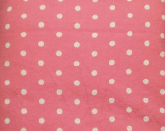 Pink with white polka dots flannel fitted crib sheet