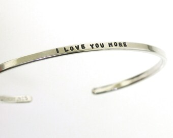 I Love You More, sterling silver cuff bracelet, gift for her, hand stamped jewelry by Kathryn Riechert