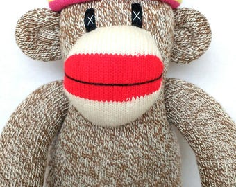 Traditional red heel Sock Monkey with striped rainbow hat