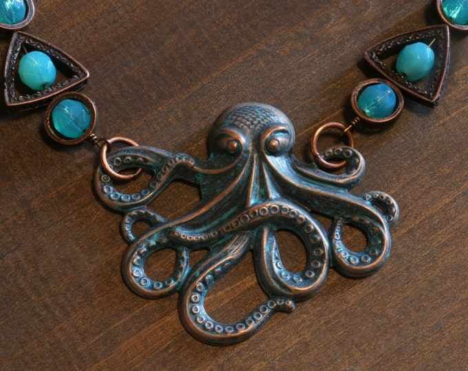 Steampunk Jewelry,Nautical Necklace - Verdigris Copper Octopus with and faceted aqua vaseline glass - UV Glowing