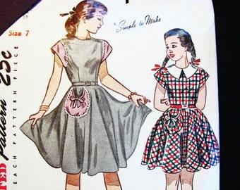 Vintage Girls Dress Pattern size 7 Girls Cap Sleeve Dress Back Button Sewing Pattern UNCUT