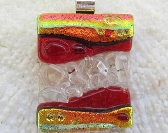 Golden orange and red fused glass texture pendant