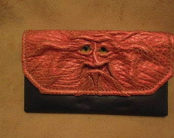 Grichels leather ladies wallet - scaly metallic red with yellow slit pupil eyes