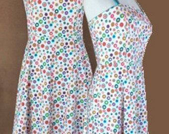 White cotton sleeveless summer dress with multicolored dots