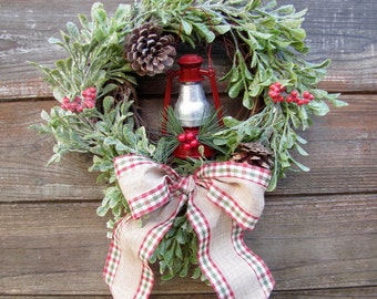 Christmas Wreath with Red Lantern, Pinecones, and Red Berries