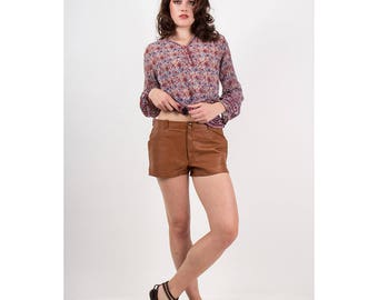 Vintage leather hot pants / 1970s low rise short shorts / Hip hugger brown leather micro shorts M