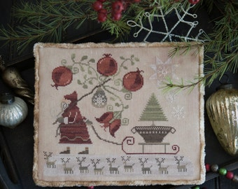 Pomegranate Santa Christmas cross stitch pattern by Plum Street Samplers at thecottageneedle.com