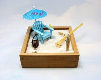 miniature zen beach garden kit, miniature adirondack chair, beverage, basket, shells, umbrella, seagull, rake