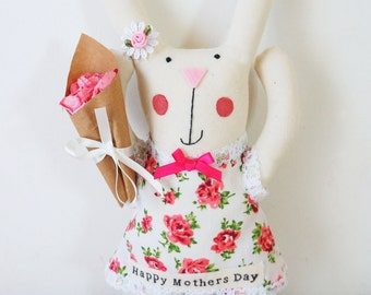 Mothers day gift bunny rabbit holding  bouquet
