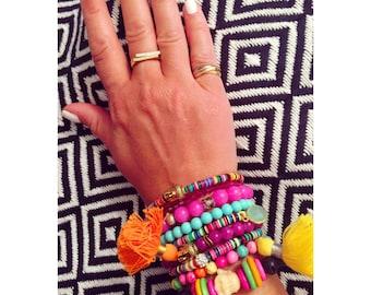 yoga buddha stretch bracelet; Bright purple boho chic beaded bracelet with bright orange tassel and gold buddha; tassel bracelet