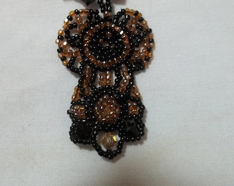 CLEARANCE SALE:  Black and taupe short beaded necklace