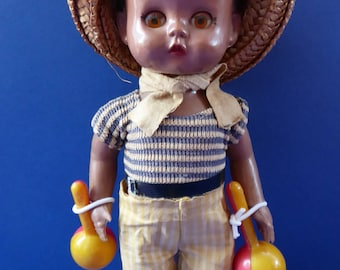 Little Vintage 1960s Hard Plastic Doll. Sweet Little Caribbean Boy With Maracas, with Original Costume and Raffia Hat
