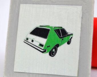 Tile magnet with Green Gremlin car retro
