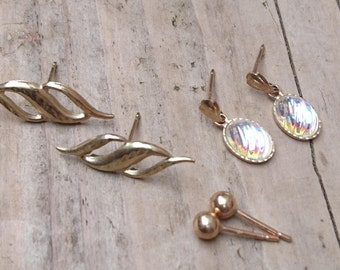 Three pairs of 9k gold earrings
