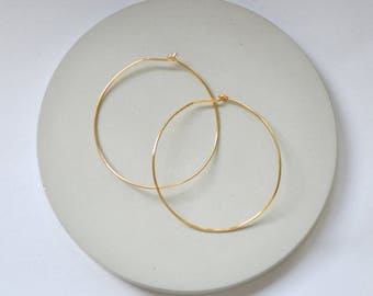 Curved featherlight hoops // symmetrical large light hoop earrings