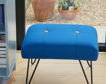 Upholstered wool footstool with steel hairpin legs
