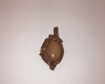 Orange calcite wire wrapped pendant