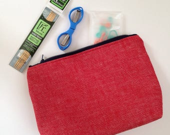 Red denim pouch fully lined with a navy blue nautical anchor l print 7 inch fine tooth metal zipper