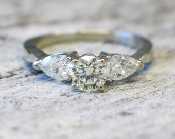 Vintage Round and Pear Cut Diamond Three Stone Engagement Ring