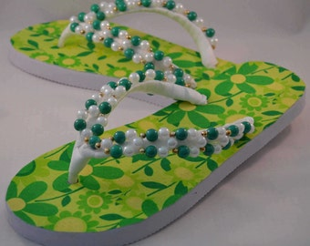 Flowery green flip flops