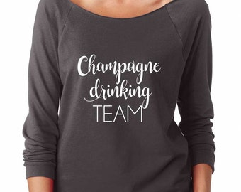 Champagne Drinking Team Shirt. Super Soft & Lightweight Women's Raw Edge Boat Neck Terry Sweatshirt with 3/4 length sleeves.