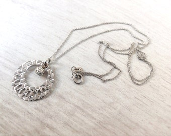 Tiny sterling silver chain with round pendant and rhinestone sphere vintage