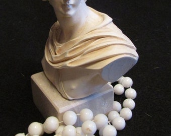 Roman bust of a woman on a marble block, this would make a lovely statement piece on a bookshelf or desk