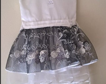 A line flower girle dress with a  white ribbon binding