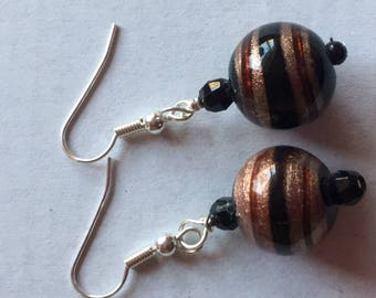 Silver earrings for pierced ears with round bead droplet.