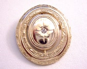 Avon Kensington Starburst Reversible Locket Pin Brooch Gold Tone Vintage 1984 Precious Pictures Swivel Crystal Oval Frame