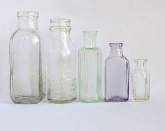 Vintage Embossed Bottle Collection Antique Poison Apothecary Purple Aqua Glass Set of Five