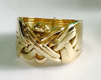 9k gold 8 band puzzle ring