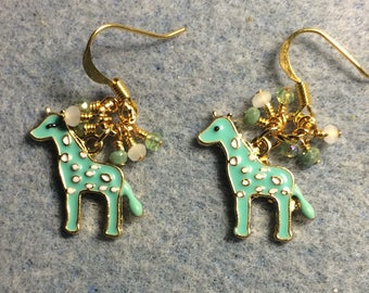 Light teal green spotted enamel giraffe charm earrings  with tiny dangling light green and white Chinese crystal beads.