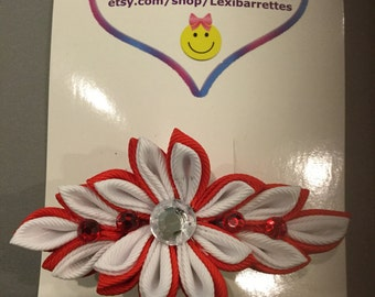 red and white flower barrette