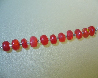 Ethiopian Red Opal Smooth Rondelle Beads Set of 11