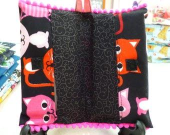 Book-style Tissue Cozy. Cute kittens on black, black swirl inside. Hanger loop & velcro closure. Washable