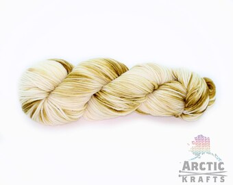 Toasted Marshmallow, hand dyed worsted weight yarn. 220 yards