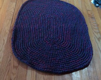 """Handmade crocheted dark blue, red and green rag rug approximately 34""""x 24"""""""