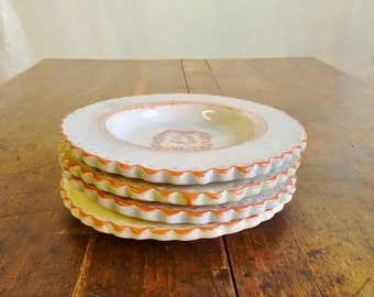 4 small scalloped edge terracotta dishes