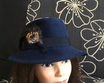 Dark blue vintage hat with a nice feather decor on the one of side made by Wertarbeit