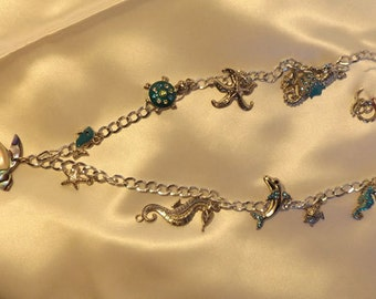 Ocean-life charm necklace with mother of pearl turtle pendant