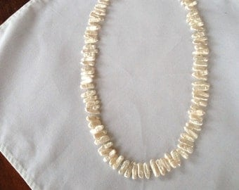 Long necklace of white freshwater biwa pearls