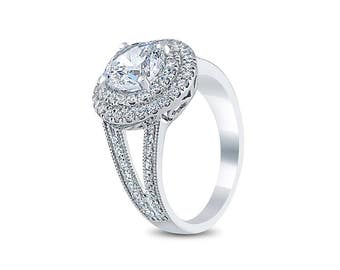 Custom Made Double Halo, Split-Shank Engagement Ring 3/4cts diamonds F+/SI and with 1ct Diamond Stimulant as a center stone.
