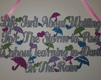 It's not about waiting for the storm to pass it's about learning to dance in the rain - hanging plaque