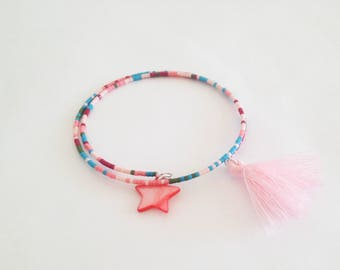 Bracelet on a thread of memory shape with miyuki tassel and star charm beads pink