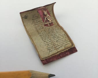 1/12 scale scroll with leather effect cover and vintage decoration