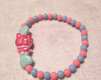 Blue and pink cat person beaded bracelet